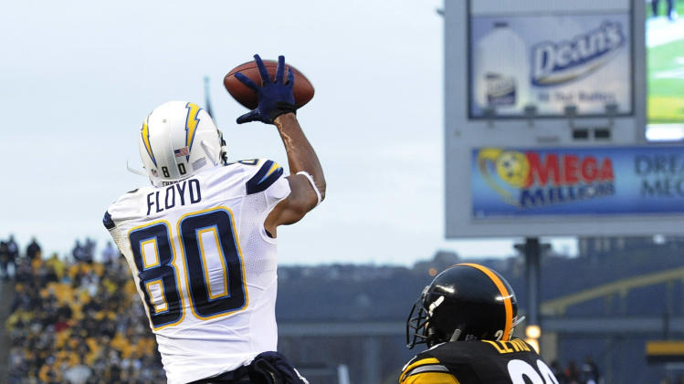 San Diego Chargers wide receiver Malcom Floyd (80) catches the ball for a touchdown in front of Pittsburgh Steelers cornerback Keenan Lewis (23) in the third quarter of an NFL football game on Sunday, Dec. 9, 2012, in Pittsburgh. (AP Photo/Don Wright)