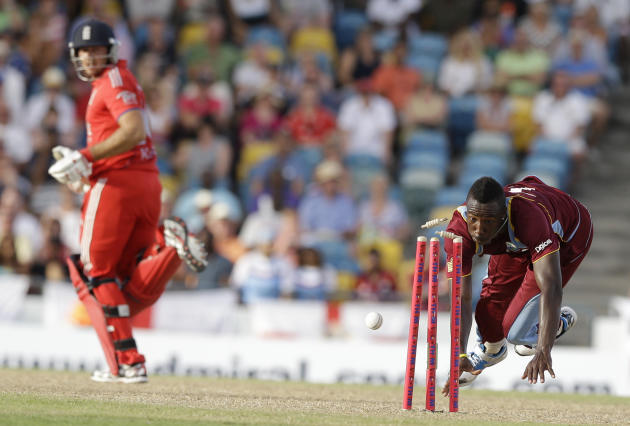 ALTERNATIVE CROP OF XRM120 - West Indies' Andre Russell runs out England's James Tredwell during their first T20 International cricket match at the Kensington Oval in Bridgetown, Barbados, Sun