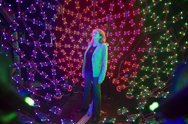 In this photo taken Tuesday, Jan. 29, 2013, University of Southern California Institute for Creative Technologies manager, Lori Weiss relaxes to music synchronized with color LEDs, inside the Lighting