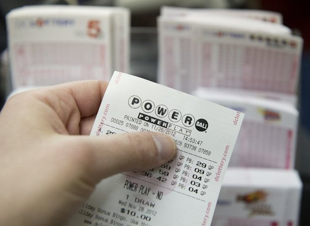 A Powerball lottery ticket is seen in a convenience store in Washington, DC on November 26, 2012. The immigrant owner of a New Jersey convenience store has come forward to claim the $338.3 million jackpot in the Powerball lottery, media reports said Tuesday