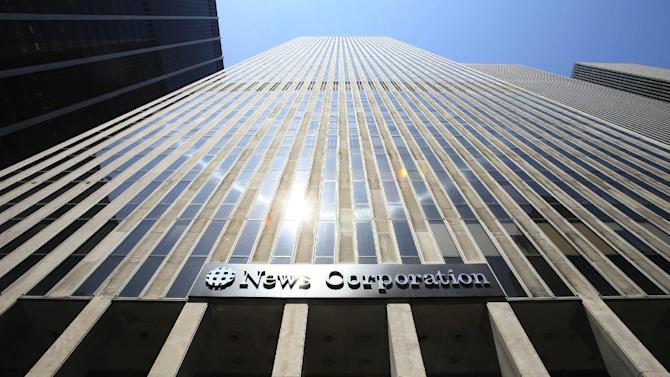 FILE -In this Tuesday, July 31, 2007, file photo, News Corp's headquarters is shown in New York. News Corp. said Monday, Dec. 3, 2012, that its new publishing company will keep the News Corp. name, while its separate media and entertainment company will be renamed Fox Group.(AP Photo/Mark Lennihan,file)