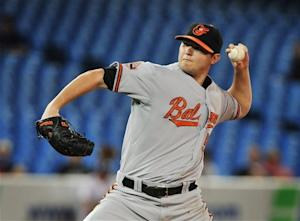 Orioles grab share of AL East lead with win