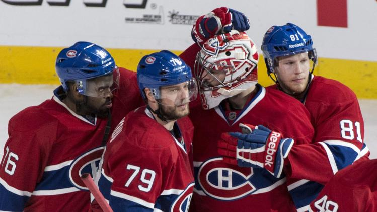 Montreal Canadiens' P.K. Subban, from left, Andrei Markov, Carey Price and Lars Eller, celebrate their victory over the Boston Bruins in an NHL playoff hockey game on Monday, May 12, 2014, in Montreal