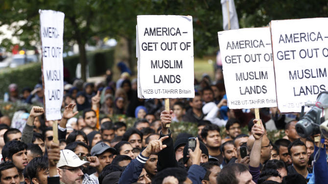 Supporters of Islamic political movement Hizb ut-Tahrir protest outside the US Embassy in London against the US made anti-Muslim film mocking the Prophet Mohammad, Sunday, Sept. 16, 2012. (AP Photo/Sang Tan)