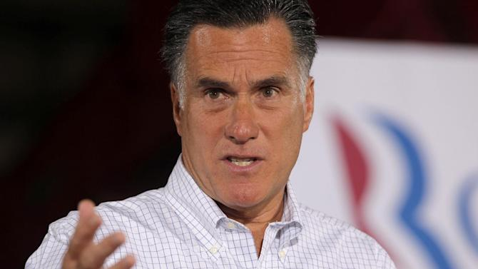 """In this Aug. 3, 2012, photo, Republican presidential candidate, former Massachusetts Gov. Mitt Romney speaks to reporters after he campaigned at McCandless Trucking in North Las Vegas, Nev. Leading Republicans on Sunday, Aug. 5, 2012, accused the Senate Democratic leader Harry Reid of lying by passing along an anonymous claim that GOP presidential candidate Mitt Romney hasn't paid taxes for 10 years. Republican Party chairman Reince Priebus called Reid a """"dirty liar.""""  (AP Photo/Charles Dharapak)"""