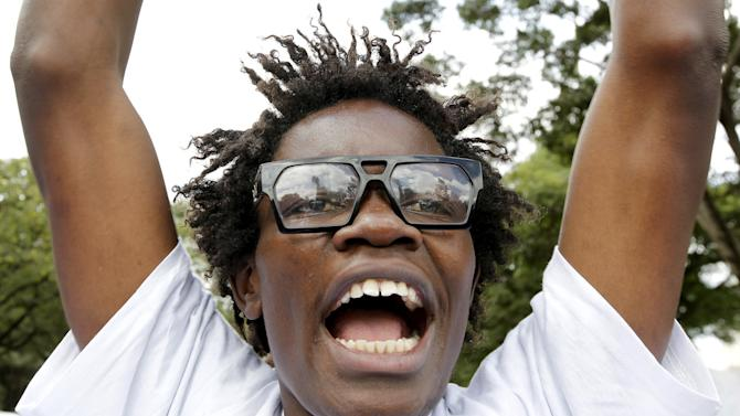 A member of the anti-gay caucus chants slogans against the lesbian, gay, bisexual, and transgender (LGBT) community as they march along the streets in Kenya's capital Nairobi