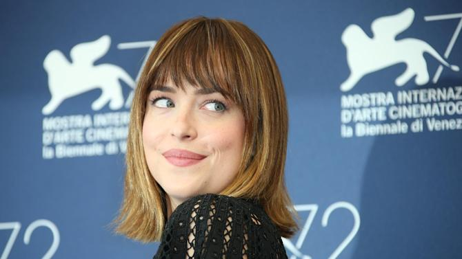 Dakota Johnson poses for photographers at the photo call for the film Black Mass during the 72nd edition of the Venice Film Festival in Venice, Italy, Friday, Sept. 4, 2015. The 72nd edition of the festival runs until Sept. 12. (Photo by Joel Ryan/Invision/AP)