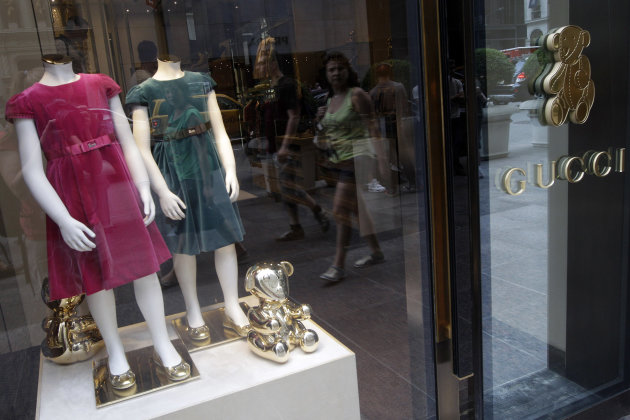In this July 19, 2012 photo, girls dresses appear on display at the Gucci children's boutique on Fifth Avenue in New York. Gucci's two-level children's boutique on New York's Fifth Avenue, next door t