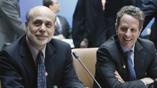 Federal Reserve Chairman Ben Bernanke, left, sits with Treasury Secretary Timothy Geithner before a meeting of the G-20, Friday, April 15, 2011, at the World Bank/IMF Spring Meetings 2011 in Washington. (AP Photo/Jacquelyn Martin)