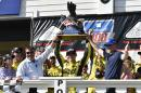 Matt Kenseth, center, celebrates in Victory Lane with the trophy after winning the NASCAR Pocono 400 auto race, Sunday, Aug. 2, 2015, in Long Pond, Pa. (AP Photo/Derik Hamilton)