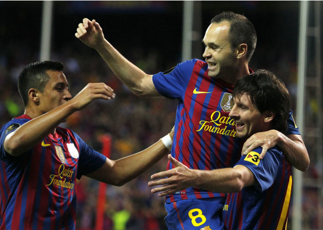 FC Barcelona's Lionel Messi from Argentina, right,  celebrates his goal with Andres Iniesta, centre, and Alexis Sanchez from Chile, left, during the final Copa del Rey  soccer match against Athletic B