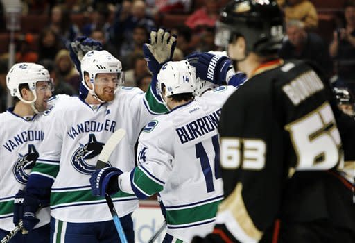 Sedin brothers lead Canucks over Ducks 5-2