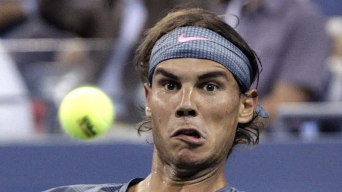 Rafael Nadal of Spain keeps his eyes on the ball as he plays Rogerio Dutra Silva of Brazil at the U.S. Open tennis championships in New York