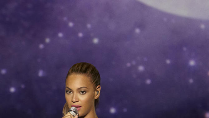 """In this photo provided by Parkwood Entertainment, singer Beyonce performs """"I Was Here"""" in the United Nations General Assembly Hall, Friday, Aug. 10, 2012. Beyonce performed in front of hundreds, including Julia Stiles, R&B singer The-Dream and songwriter Diane Warren, who wrote """"I Was Here."""" (AP Photo/Parkwood Entertainment, Cliff Watts)"""