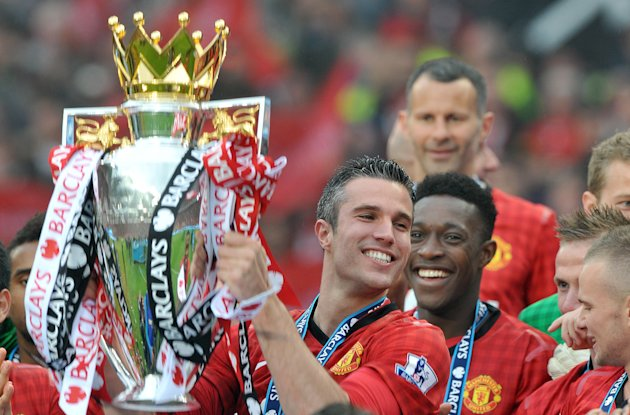 File photo dated 12/05/2013 of Manchester United's Robin Van Persie lifting the Barclays Premier League trophy after the Barclays Premier League match at Old Trafford, Manchester.