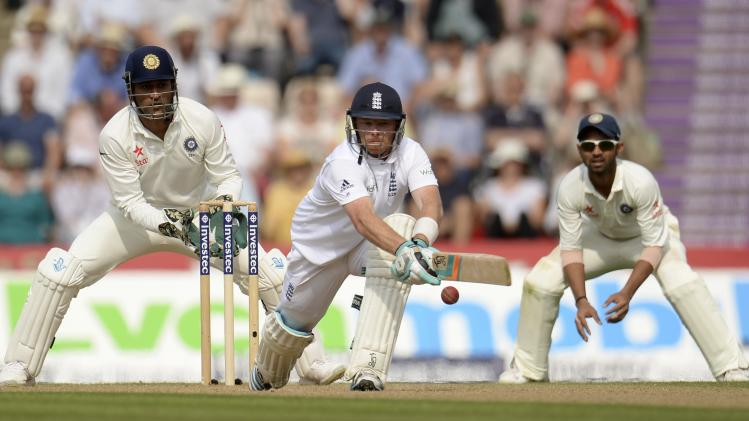 England's Bell prepares to hit the ball as India's Dhoni looks on during the third cricket test match at the Rose Bowl cricket ground in Southampton