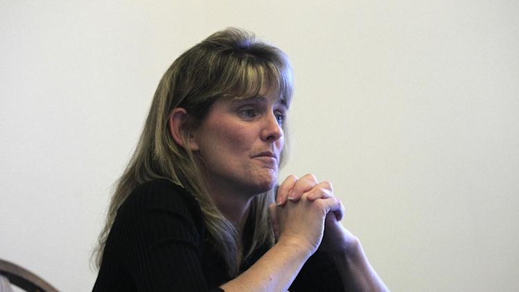 """In this Oct. 17, 2012 photo, Jody Robinson, the younger sister of James Cotaling, who was murdered in 1990, talks about him at her home in Davisburg, Mich. When the phone rang on Mother's Day morning 1990, it awakened the 17-year-old Jody. Downstairs in her family's lakeside house she could heard her mother on the line with her brother's girlfriend, talking about a """"missing persons report"""" and urging the younger woman to just calm down. Police searched for three days before finding his body inside an abandoned house. (AP Photo/Carlos Osorio)"""