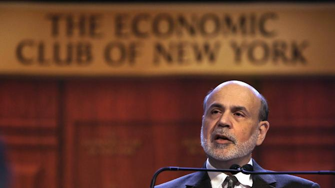 """Federal Reserve Chairman Ben Bernanke addresses a luncheon gathering of The Economic Club of New York, in New York,  Tuesday, Nov. 20, 2012.  Bernanke on Tuesday urged Congress and the Obama administration to strike a budget deal to avert tax increases and spending cuts that could trigger a recession next year. Without a deal, the measures known as the """"fiscal cliff"""" will take effect in January. (AP Photo/Richard Drew)"""