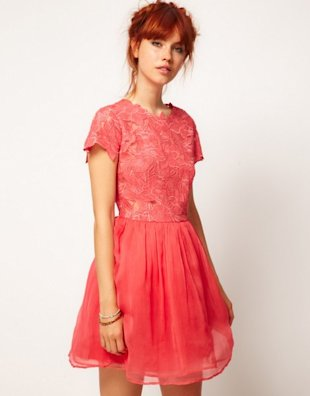 A deep coral colored dress with an intriguing floral neckline and a simple hem, from Asos.