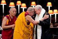 The Dalai Lama (2nd L) embraces John M Templeton, (R) President of the John Templeton Foundation, during a ceremony in St Paul's Cathedral. Tibet's exiled spiritual leader received one of the world's richest prizes