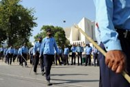 "Police surround Pakistan's Supreme Court after it disqualified Prime Minister Yousuf Raza Gilani from office on Tuesday in a stunning move likened to a ""judicial coup"" that threw the country into fresh turmoil"