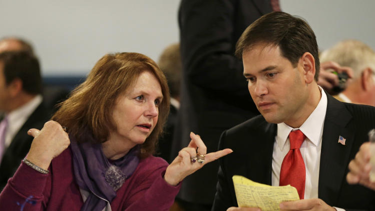 Patty Cownie, of Des Moines, Iowa, talks with U.S. Sen. Marco Rubio, R-Fla., during Iowa Gov. Terry Branstad's annual birthday fundraiser, Saturday, Nov. 17, 2012, in Altoona, Iowa. (AP Photo/Charlie Neibergall)