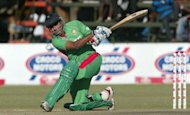 Bangladesh batsman Tamim Iqbal plays during the first match against Zimbabwe of the tri-nation Twenty20 tournament at Harare Sports Club. A fine 62 from opener Hamilton Masakadza set up hosts Zimbabwe for an 11-run victory over Bangladesh in the opening match of a Twenty20 tri-nations tournament that includes South Africa