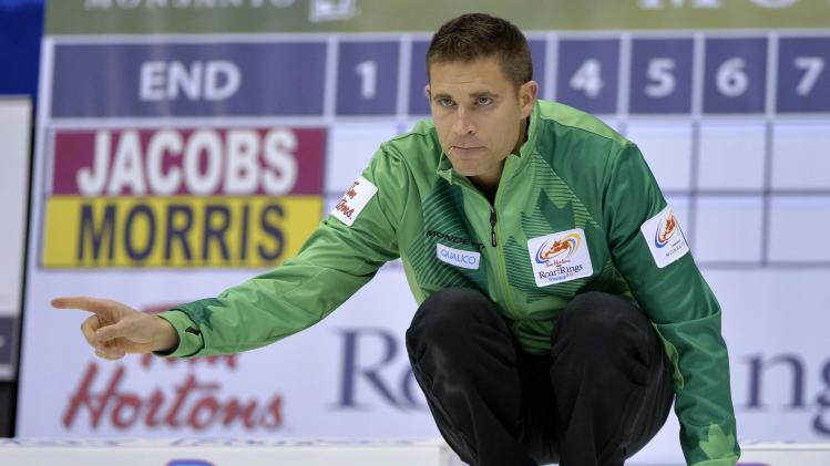 Skip John Morris instructs his teammates during his game against Team Jacobs at the Roar of the Rings Canadian Olympic Curling Trials in Winnipeg