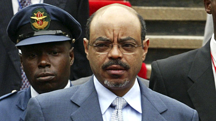 FILE - In this  May 21 2007 file photo, Ethiopian Prime Minister Meles Zenawi, surrounded by bodyguards, arrives for the 12th Summit of the Common Market for Eastern and Southern Africa (COMESA), at the United Nations Complex in Gigiri, Nairobi, Kenya. Meles died Monday, Aug. 20, 2012 following weeks of illness, Ethiopian State media reported. He was 57. (AP Photo/Sayyid Azim, File)