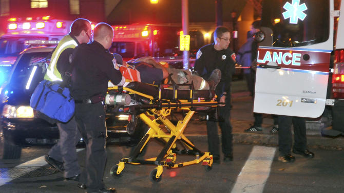An injured firefighter is wheeled from the scene after a building was leveled by an explosion in downtown Springfield, Mass. on Friday, Nov. 23, 2012. (AP Photo/Springfield Republican, Don Treeger)  MANDATORY CREDIT
