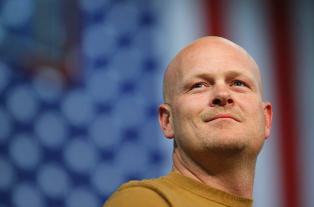 Joe Wurzelbacher, also known as Joe the Plumber, stands onstage at a campaign rally with U.S. Republican presidential nominee Senator John McCain in Mentor, Ohio in this file photo taken October 30, 2008. Wurzelbacher, a conservative, announced on Sunday that he recently had the fortune of being hired by a great company, Chrysler Corporation, where all workers must be United Automobile Workers union members. REUTERS/Brian Snyder/Files (UNITED STATES - Tags: POLITICS BUSINESS EMPLOYMENT)