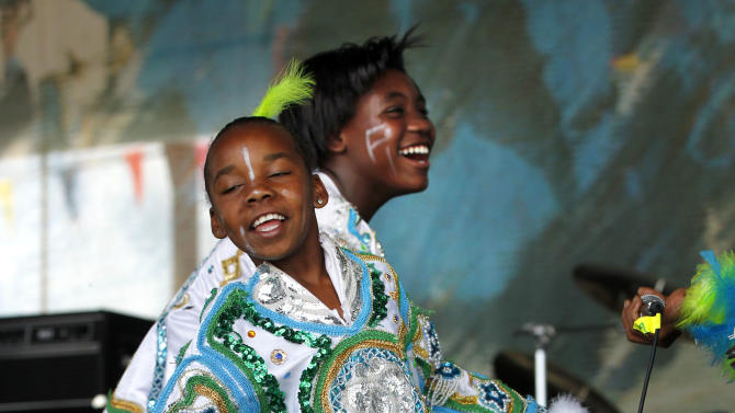 Members of Fi Yi Yi & the Mandingo Warriors, a Mardi Gras Indian tribe, perform at the New Orleans Jazz and Heritage Festival in New Orleans, Thursday, May 3, 2012. (AP Photo/Gerald Herbert)