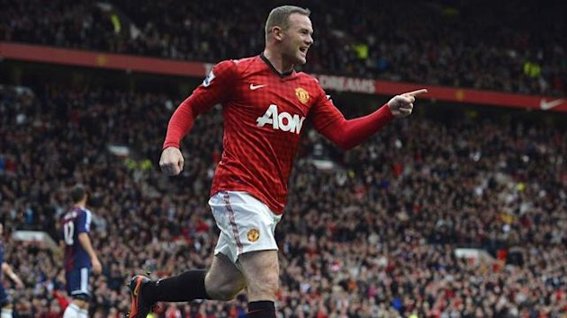 Manchester United&#39;s Wayne Rooney celebrates scoring against Stoke City during their English Premier League soccer match in Manchester