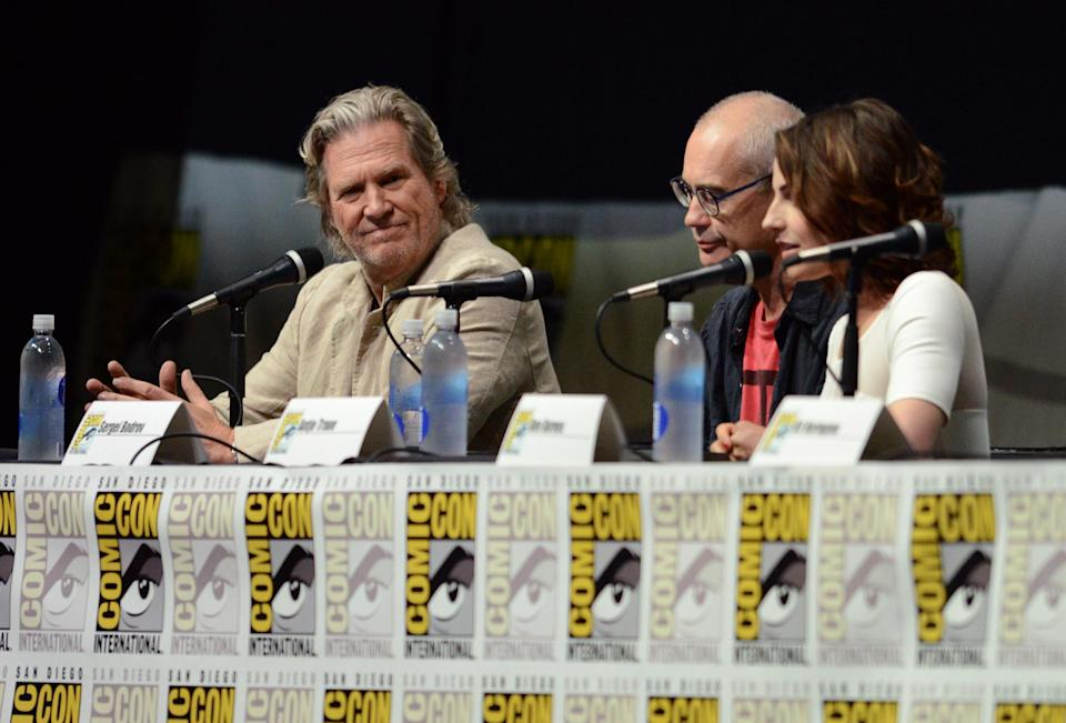 "Jeff Bridges, left, Sergey Bodrov, center, and Antje Traue attend the ""Seventh Son"" panel on Day 4 of Comic-Con International on Saturday, July 20, 2013 in San Diego. (Photo by Jordan Strauss/Invision/AP)"