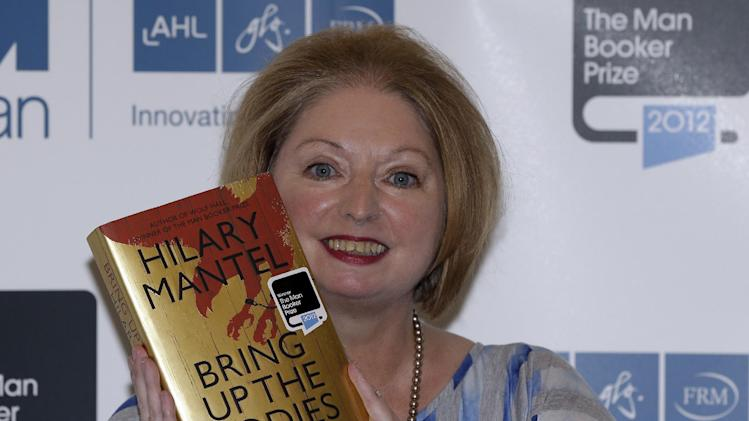 FILE - This Tuesday, Oct. 16, 2012 file photo shows Hilary Mantel, winner of the Man Booker Prize for Fiction, with a copy of her book 'Bring up the Bodies', shortly after the award ceremony in central London. Organizers of the Booker Prize announced Wednesday Sept. 18, 2013 that starting in 2014, the prize will be open to novels written in English and published in Britain, regardless of the author's nationality. Founded in 1969, the Booker has previously been open only to writers from Britain, Ireland and the 54-nation Commonwealth of former British colonies. (AP Photo/Lefteris Pitarakis, File)