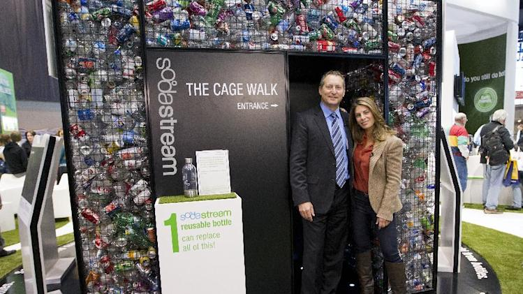 """COMMERCIAL IMAGE - In this photograph released by SodaStream on Monday, Mar. 12, 2012, Jillian Michaels, right, and CEO Daniel Birnbaum at The SodaStream Cage Exhibit: """"Unbottle America"""" at the 2012 International Home & Housewares Show in Chicago. (David Stluka/AP Images for SodaStream)"""