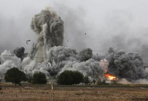 Thick smoke, debris and fire rise following an airstrike…