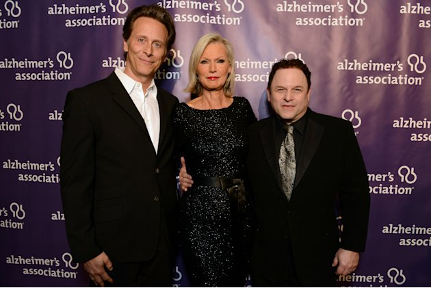 From left, actor Steven Weber, Alzheimer's Association's Laurie Grad,  and actor Jason Alexander arrive at the 21st Annual 'A Night at Sardi's' to benefit the Alzheimer's Association at the Beverly Hi