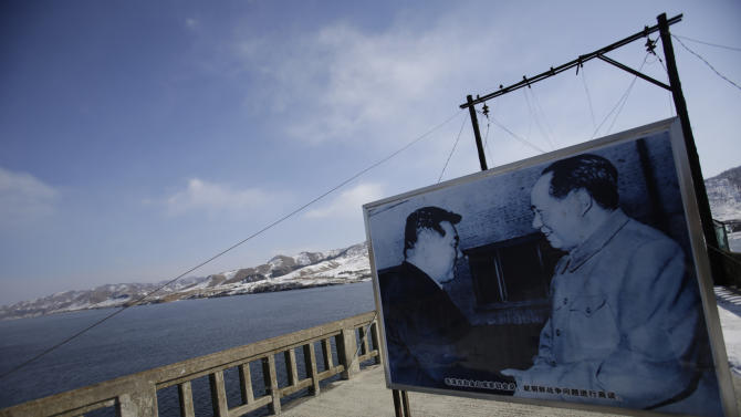 In this Feb. 7, 2013 photo, a picture of Mao Zedong, founder of the People's Republic of China, right, and North Korea's late leader Kim Il Sung is displayed on the Hekou Bridge, which once linked China and North Korea before it was bombed in the 1950's during the Korean War, in Hekou, China. China's patience with North Korea is wearing thin, and a widely-expected nuclear weapons test by the latter could bring that frustration to a head. Beijing signaled its growing unhappiness by agreeing to tightened U.N. sanctions after North Korea launched a rocket in December, eliciting harsh criticism from Pyongyang and comment from China watchers surprised by Beijing's unusually tough line. (AP Photo/Eugene Hoshiko)