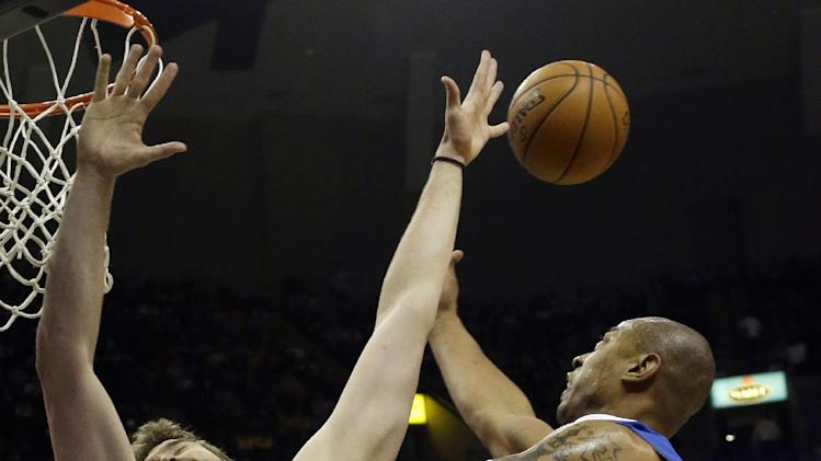 Memphis Grizzlies' Marc Gasol (33), of Spain, blocks a shot by Los Angeles Clippers' Caron Butler (5) during the first half of Game 6 in a first-round NBA basketball playoff series in Memphis, Tenn., Friday, May 3, 2013. (AP Photo/Danny Johnston)