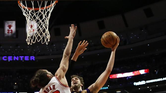 Los Angeles Lakers forward Pau Gasol (16) shoots between Chicago Bulls center Joakim Noah (13) and Carlos Boozer during the second half of an NBA basketball game Monday, Jan. 21, 2013, in Chicago. The Bulls won 95-83. (AP Photo/Charles Rex Arbogast)