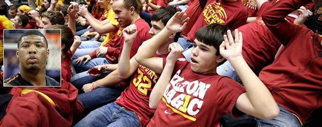 Fans mock hoops star with mass stunt (Marcus Smart/Getty inserted into Iowa State student section/AP