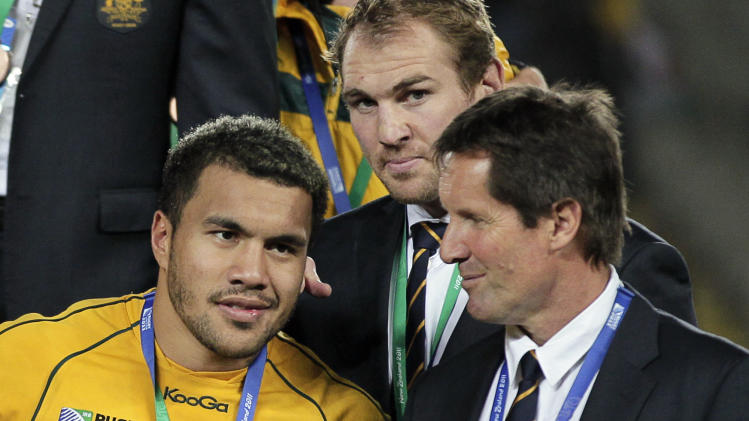 Australia's coach Robbie Deans, right, talks to player Digby Ioane, as Rocky Elsom looks on after their bronze medal Rugby World Cup victory over Wales at Eden Park in Auckland, New Zealand, Friday, Oct. 21, 2011. (AP Photo/Mark Baker)