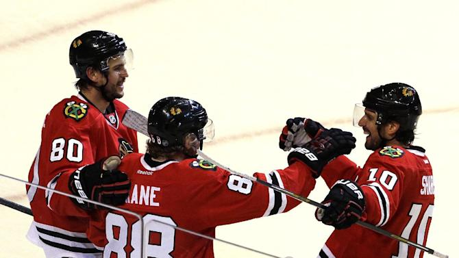 Chicago Blackhawks right wing Patrick Kane (88) celebrates with center Antoine Vermette, left, and left wing Patrick Sharp after scoring his second goal against the Minnesota Wild during the third period  of Game 2 in the second round of the NHL Stanley Cup hockey playoffs in Chicago, Sunday, May 3, 2015. The Blackhawks won 4-1. (AP Photo/Nam Y. Huh)