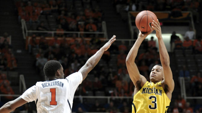Michigan's Trey Burke (3) shoots a 3-pointer in front of Illinois' D.J. Richardson (1) during the second half of an NCAA college basketball game, Sunday, Jan. 27, 2013, in Champaign, Ill. Michigan won 74-60. (AP Photo/John Dixon)