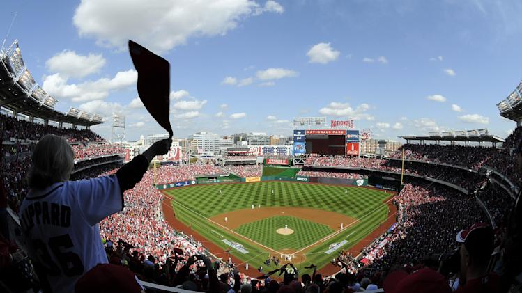 A fan waves a towel in the stands during Game 3 of the National League division baseball series between the Washington Nationals and the St. Louis Cardinals on Wednesday, Oct. 10, 2012, in Washington. (AP Photo/Nick Wass)