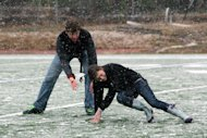 ACA students Phillip Brooks, 17, and Chandler Dare, 17, play in the snow on the school&#39;s football field in Tuscaloosa, Ala., Thursday, Jan. 17, 2013. Heavy snow fell across Tuscaloosa County Thursday. (AP Photo/Tuscaloosa News, Michelle Lepianka Carter)