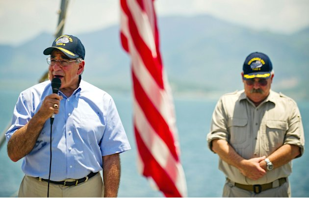 U.S. Secretary of Defense Leon Panetta, left, stands near USNS Richard E. Byrd Ship Master Captain John Sargent as he speaks to the crew aboard the cargo ship in Cam Ranh Bay, Vietnam, Sunday, June 3,