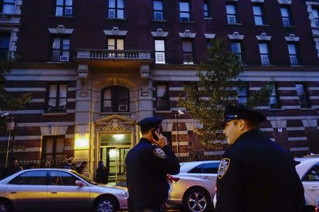 Police officers guard the building where Dr. Craig Spencer lives in New York