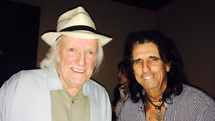 This June 17, 2014 photo released by Danny Zelisko shows Dick Wagner, left, and Alice Cooper. Wagner, the skilled guitarist who worked with Alice Cooper, Lou Reed, Kiss and Aerosmith, and also co-wrote many of Cooper's hits, died of respiratory failure Wednesday, July 30, his personal manager and business partner said Friday. He was 71. (AP Photo/Danny Zelisko)
